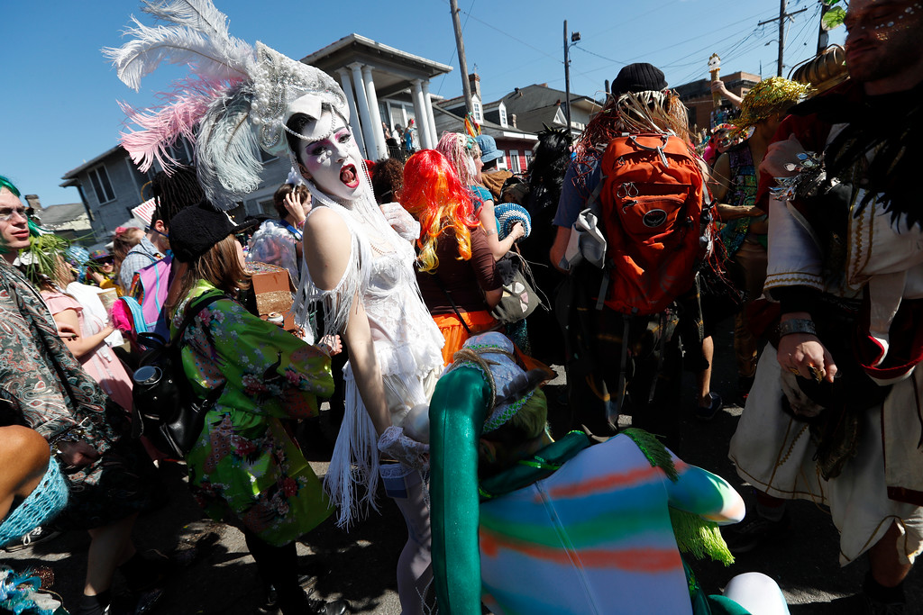 . Revelers dance during the Society de Sainte Anne parade, on Mardi Gras day in New Orleans, Tuesday, Feb. 13, 2018. (AP Photo/Gerald Herbert)