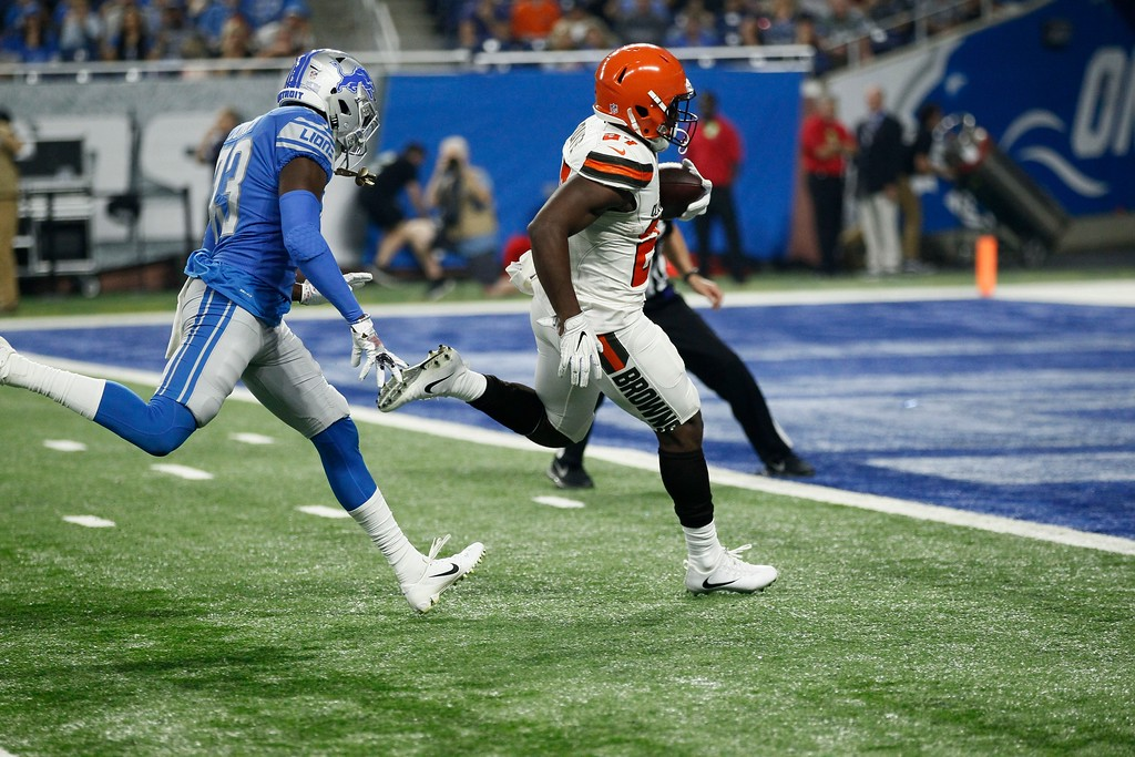 . Cleveland Browns running back Matt Dayes beats Detroit Lions defensive back Chris Jones (43) for a 42-yard rushing touchdown during the first half of an NFL football preseason game, Thursday, Aug. 30, 2018, in Detroit. (AP Photo/Duane Burleson)