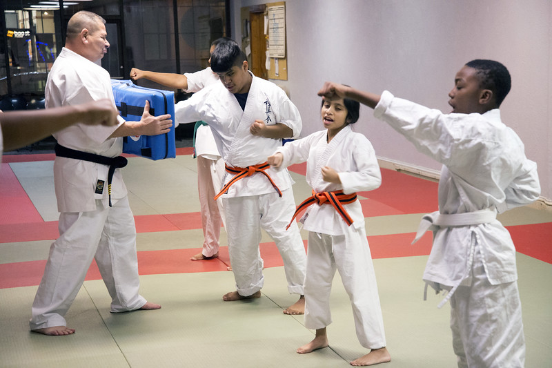 01/07/20  Wesley Bunnell   Staff  Instructor Jose Ithier walks through a class with a punching target at New Britain Judo & Dynamic Arts on West Main St in New Britain.