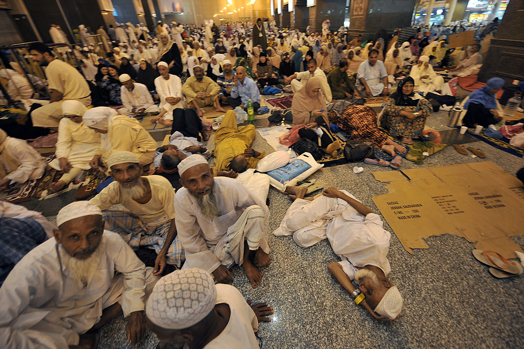 . Muslim pilgrims wait to perform evening prayers in Mecca\'s Grand Mosque on October 8, 2013, as more than two million Muslims have arrived in the holy city for the annual hajj pilgrimage. The hajj, which is one of the world\'s largest human assembly, begins on October 13 amid concerns over the deadly MERS coronavirus. (FAYEZ NURELDINE/AFP/Getty Images)