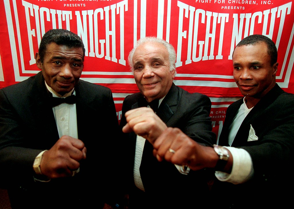 . Boxing legends Floyd Patterson, from left, Jake LaMotta and Sugar Ray Leonard display their champion fists Thursday,  Oct. 10, 1996 in Washington. The boxers gathered to help raise more than a half million dollars for local children\'s charities. (AP Photo/Mark Wilson)