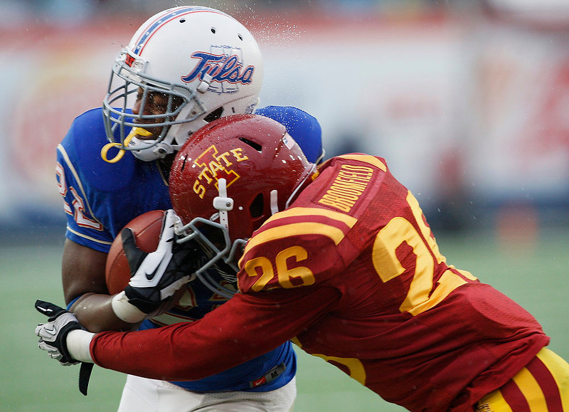 . Tulsa running back Trey Watts is stopped short of the goal line by Iowa State linebacker Deon Broomfield in the second quarter of the Liberty Bowl NCAA college football game in Memphis, Tenn., Monday, Dec. 31, 2012. (AP Photo/Charles A. Smith)