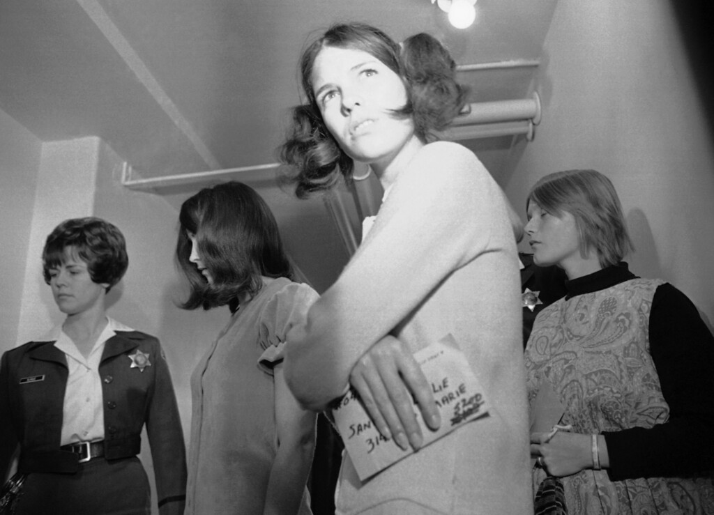 . Three young woman, indicted by a Los Angeles Grand Jury for murder, leave court after arraignment in Los Angeles, Dec.10, 1969. Susan Denise Atkins, left, 21, and Linda Kasabian, right, 20, were charged with deaths of actress Sharon Tate and six others. Leslie Van Houten, foreground,19, is accused in the deaths of Leno Labianca and his wife the night following the Tate Slayings. (AP Photo)
