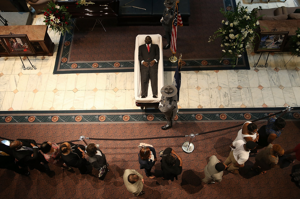 . Visitors pay their respects during an open viewing for Rev. Clementa Pinckney at the South Carolina State House June 24, 2015 in Columbia, South Carolina. Pinckney was one of nine people killed during a Bible study inside Emanuel AME church in Charleston. U.S. President Barack Obama and Vice President Joe Biden are expected to attend the funeral which is set for Friday June 26 at the TD Arena.  (Photo by Win McNamee/Getty Images)