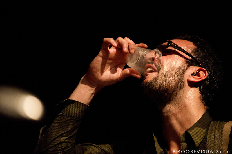 Julio Tavarez of As Tall As Lions pauses for a drink during the band's performance on May 2, 2010 at State Theatre in St. Petersburg, Florida