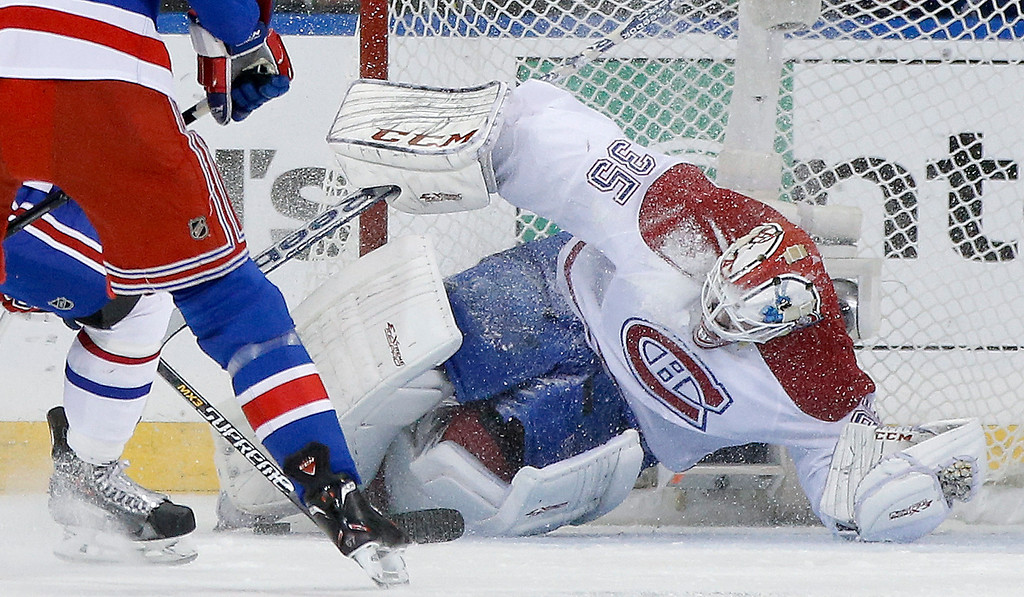 . Montreal Canadiens goalie Dustin Tokarski (35) blocks a shot on goal by the New York Rangers during the first period in Game 6 of the NHL hockey Stanley Cup playoffs Eastern Conference finals, Thursday, May 29, 2014, in New York. (AP Photo/Kathy Willens)