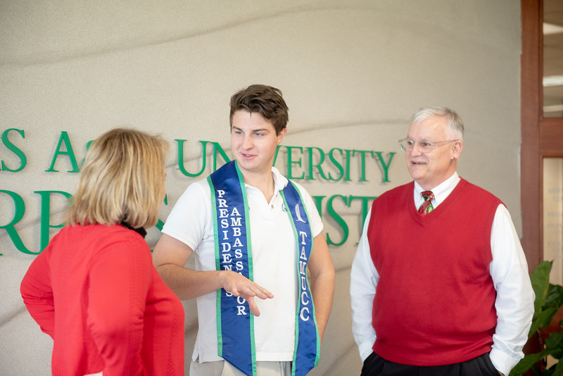Dr. Kelly Quintanilla (left) and Dr. Don Albrecht present Joey Holzer with a President's Ambassador Stole.