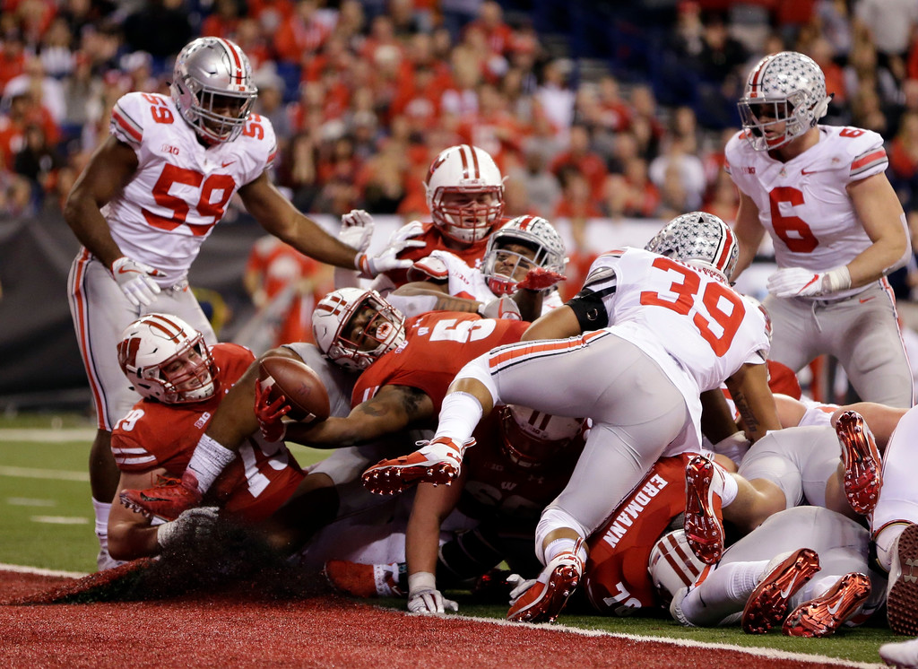 . Wisconsin running back Chris James (5) scores during the second half of the Big Ten championship NCAA college football game against Ohio State, Saturday, Dec. 2, 2017, in Indianapolis. (AP Photo/AJ Mast)