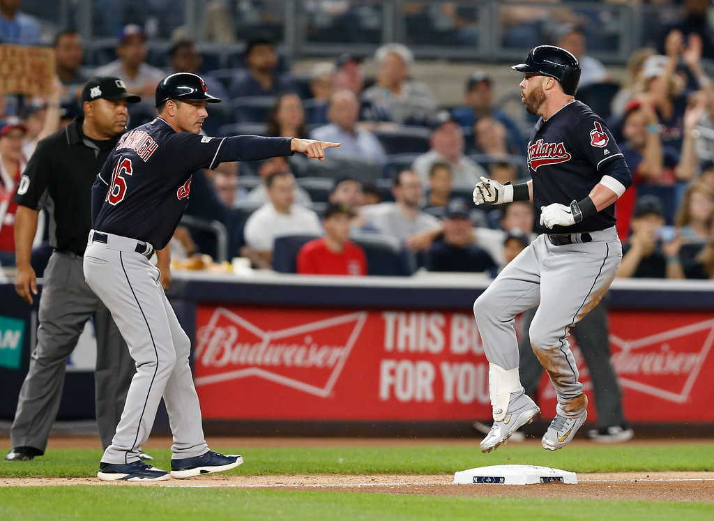 . Cleveland Indians\' Jason Kipnis, right, reacts after tripling to right field against the New York Yankees during the fourth inning in Game 3 of baseball\'s American League Division Series, Sunday, Oct. 8, 2017, in New York. (AP Photo/Kathy Willens)