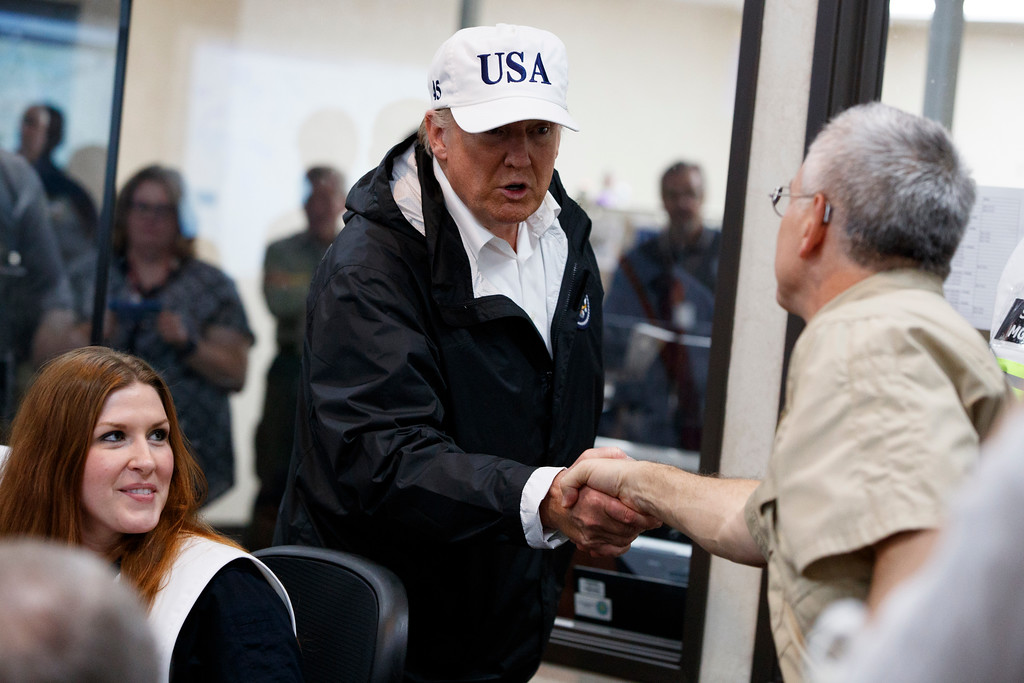 . President Donald Trump is greeted as he tours the Texas Department of Public Safety Emergency Operations Center, Tuesday, Aug. 29, 2017, in Austin, Texas. (AP Photo/Evan Vucci)