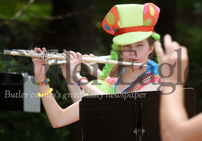 Harold Aughton/Butler Eagle: Ella Drutarosky, a rising 9th grader at Mars High School, keeps a close eye on the conductor as she player her flute during band camp.