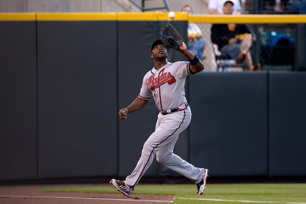 . Justin Upton #8 of the Atlanta Braves makes a catch on a ball off the bat of Charlie Blackmon (not pictured) of the Colorado Rockies for the third out of the fifth inning at Coors Field on June 9, 2014 in Denver, Colorado.  (Photo by Justin Edmonds/Getty Images)