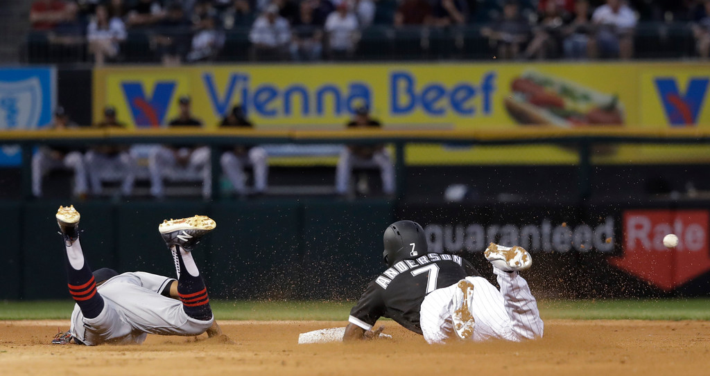 . Chicago White Sox\'s Tim Anderson (7) steals second after Cleveland Indians shortstop Francisco Lindor was unable to field a throw from catcher Roberto Perez during the fifth inning of a baseball game Wednesday, June 13, 2018, in Chicago. Anderson advanced to third on Perez\'s throwing error. (AP Photo/Charles Rex Arbogast)