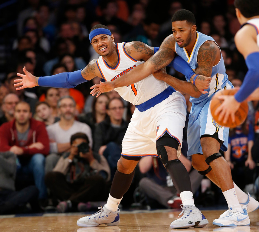 . New York Knicks forward Carmelo Anthony (7) calls for the ball from Knicks guard Pablo Prigioni, right, as Denver Nuggets forward Alonzo Gee, center, defends in the first half of an NBA basketball game in New York, Sunday, Nov. 16, 2014. (AP Photo/Kathy Willens)