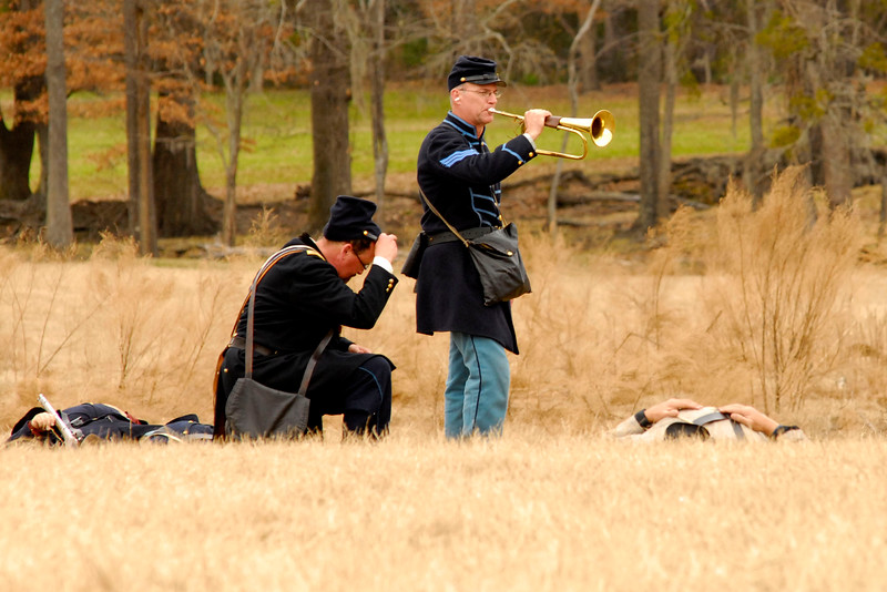 """The bugler plays a song to honor the """"fallen"""" reenactors on the field at the conclusion of the battle. The Skirmish at Gamble's Hotel happened on March 5, 1885 when 500 federal soldiers, under the command of Reuben Williams of the 12th Indiana Infantry, marched into Florence to destroy the railroad depot but were met by Confederate soldiers backed up with 400 militia. The reenactment, held by the 23rd South Carolina Infantry, was held at the Rankin Plantation in Florence, South Carolina on Saturday, March 5, 2011. Photo Copyright 2011 Jason Barnette"""