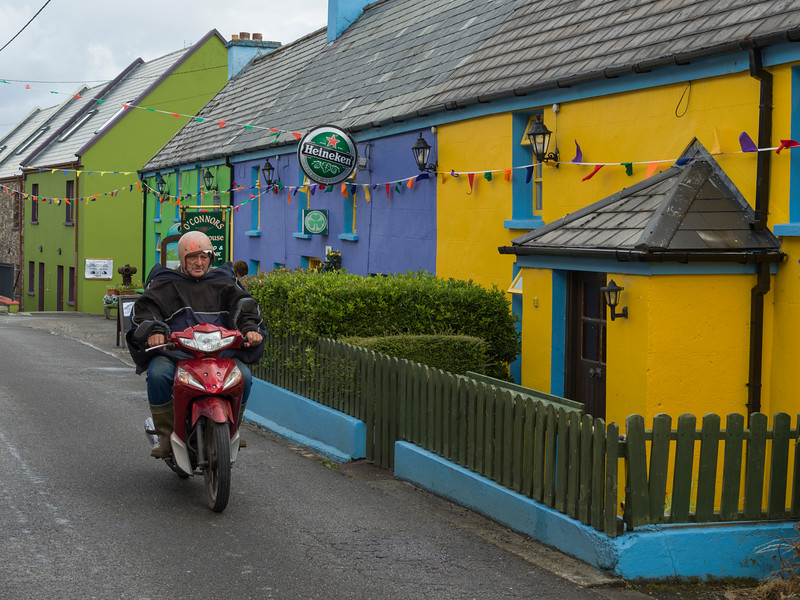 Man riding a scooter, Castlegregory, County Kerry, Republic of Ireland