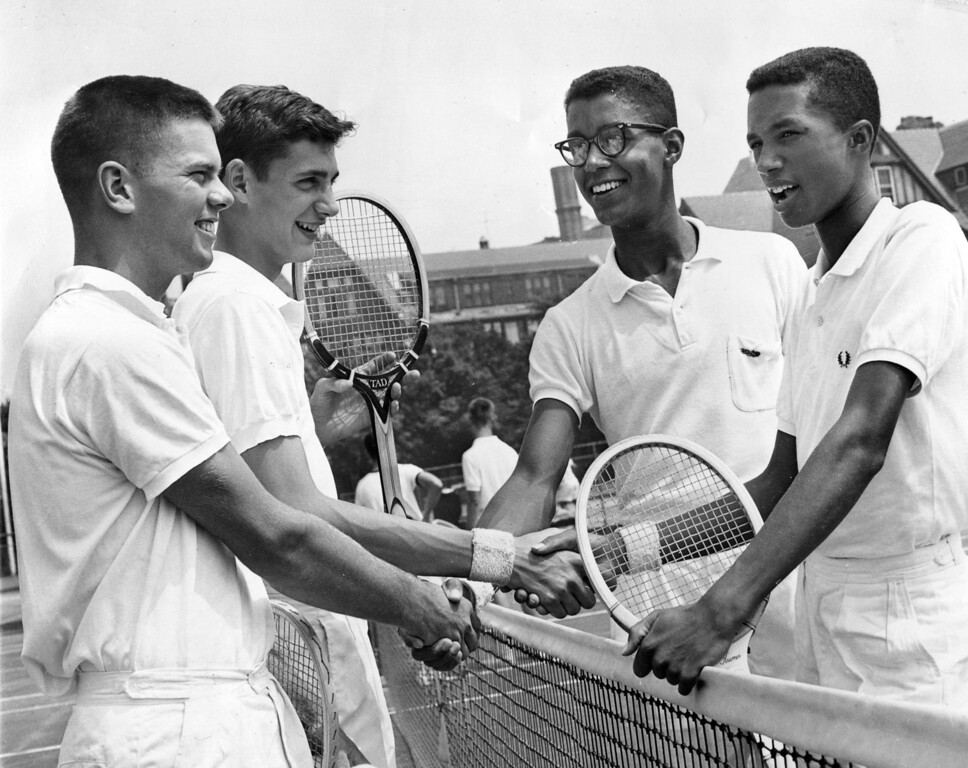 . Hubert Easton, second from right, and Arthur Ashe, right, shake hands with their opponents, John Botts, left, and Herbert Gibson, before their match in the Eastern Junior Tennis Championships at Forest Hills in the Queens section of New York, July 18, 1959.  (AP Photo/Harry Harris)