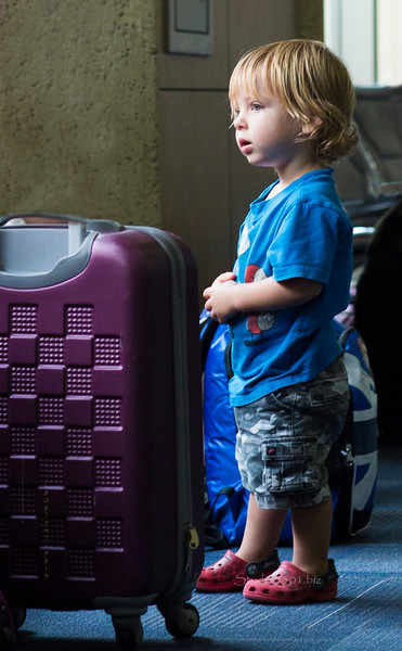 Boy near suitcase KC airport 4317.jpg