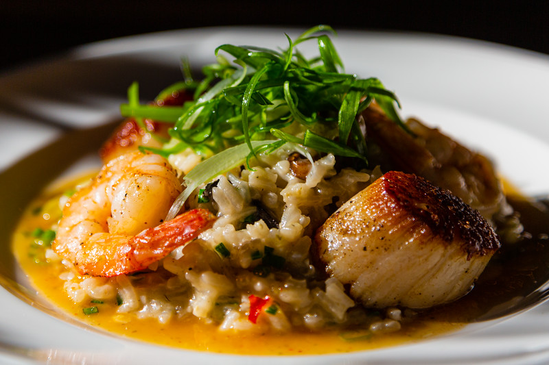 Seared scallops and shrimp with wild mushroom risotto Yuzu vinaigrette from City Cellar in West Palm Beach, FL on December 6, 2019. City Cellar is turning 20 years old.[JOSEPH FORZANO/palmbeachpost.com]