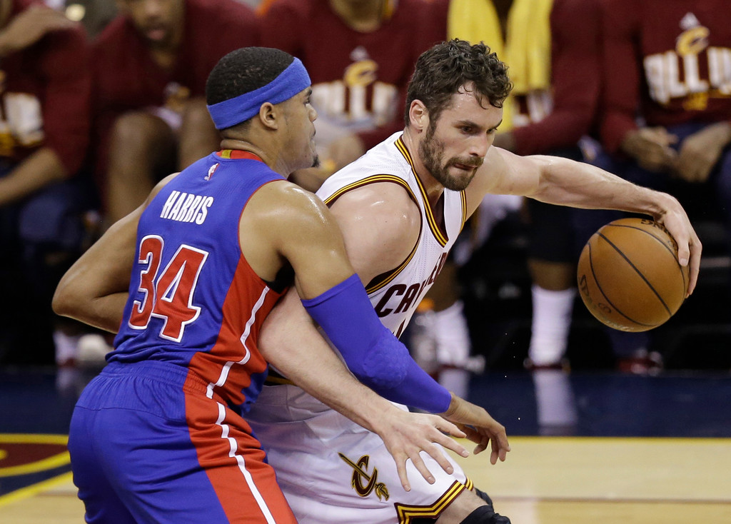 . Cleveland Cavaliers\' Kevin Love (0) drives past Detroit Pistons� Tobias Harris (34) in the first half in Game 2 of a first-round NBA basketball playoff series, Wednesday, April 20, 2016, in Cleveland. (AP Photo/Tony Dejak)