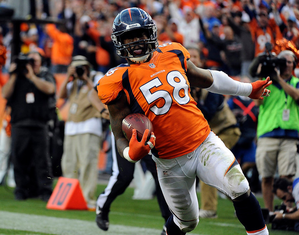 . Denver Broncos outside linebacker Von Miller #58 runs in for a touchdown during the third quarter.  The Denver Broncos vs The Tampa Bay Buccaneers at Sports Authority Field Sunday December 2, 2012. Tim Rasmussen, The Denver Post