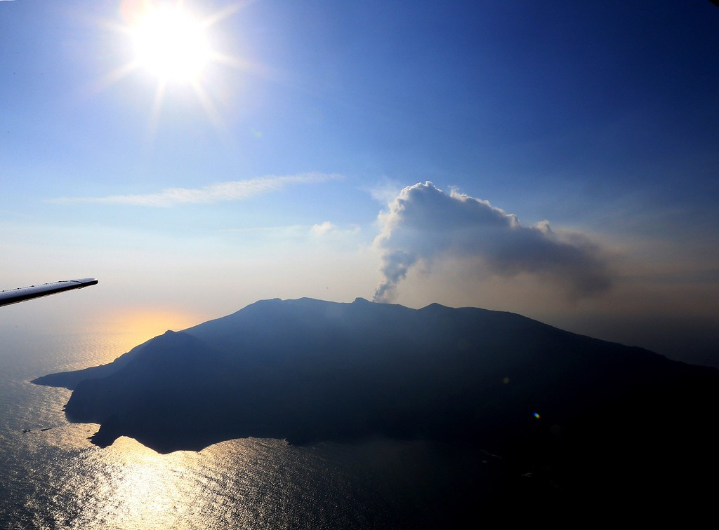 . An aerial view taken on May 29, 2015 shows smoke rising from Mount Shindake on Kuchinoerabu island in the Kagoshima prefecture of Japan\'s southern island of Kyushu. A violent volcanic eruption in southern Japan forced the evacuation of an island, as a huge column of ash was shot high into the sky.    AFP PHOTO / JIJI  PRESS/AFP/Getty Images