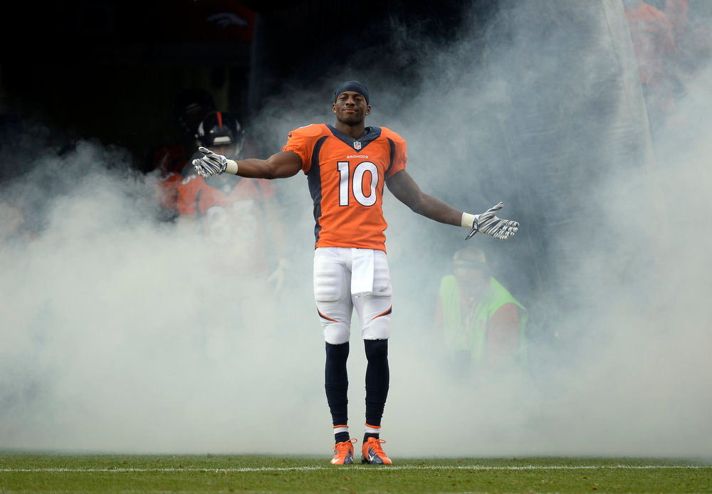 . Wide receiver Emmanuel Sanders (10) of the Denver Broncos takes a bow as he enters the field prior to the start of the game.  The Denver Broncos vs the Seattle Seahawks At Sports Authority Field at Mile High. (Photo by John Leyba/The Denver Post)