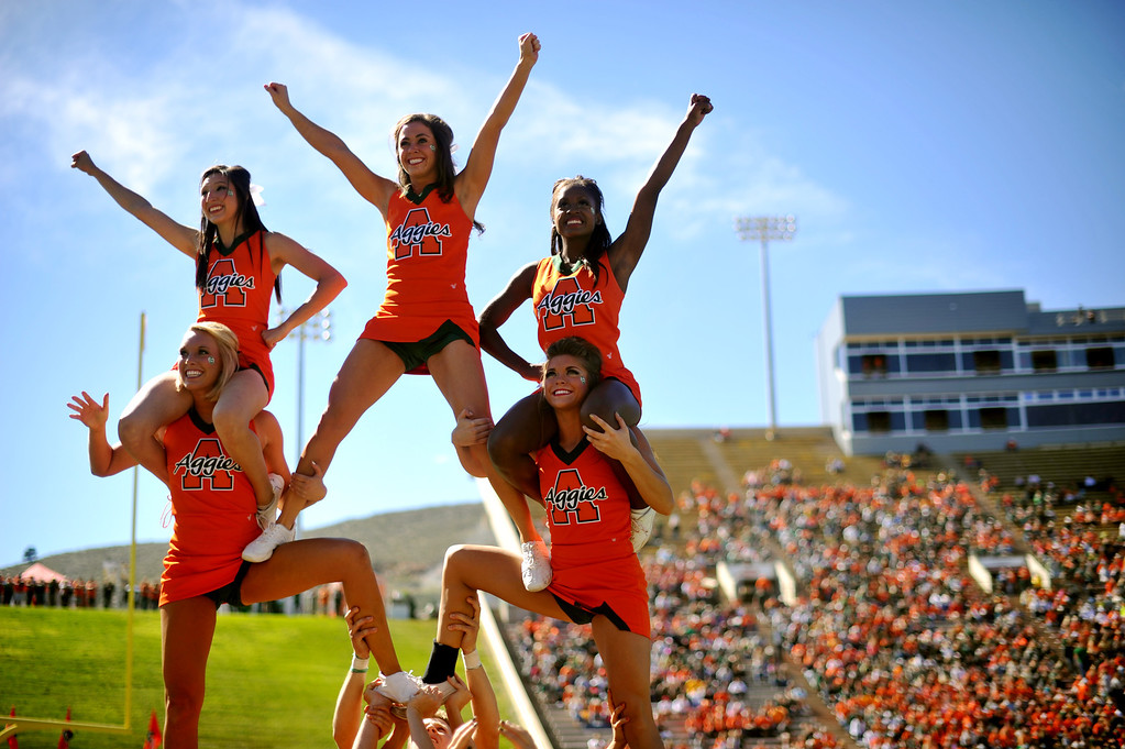 . FORT COLLINS, CO - September 28 : Colorado State University cheerleaders perform on the field during the game against University of Texas at El Paso at Hughes Stadium. Fort Collins, Colorado. September 28, 2013. (Photo by Hyoung Chang/The Denver Post)