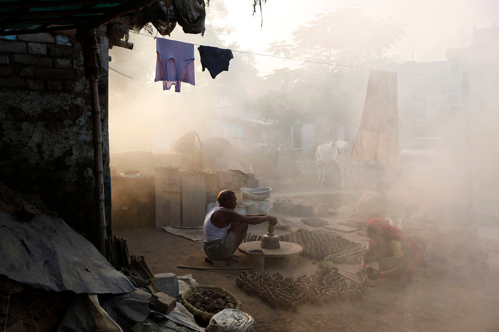 . An Indian potter makes earthen lamps for the upcoming Diwali festival in Allahabad, India on Oct. 23, 2013. Hindus light lamps, wear new clothes, exchange sweets and gifts and pray to goddess Lakshmi during the festival of lights, which will be celebrated on Nov. 3. (AP Photo/Rajesh Kumar Singh, File)