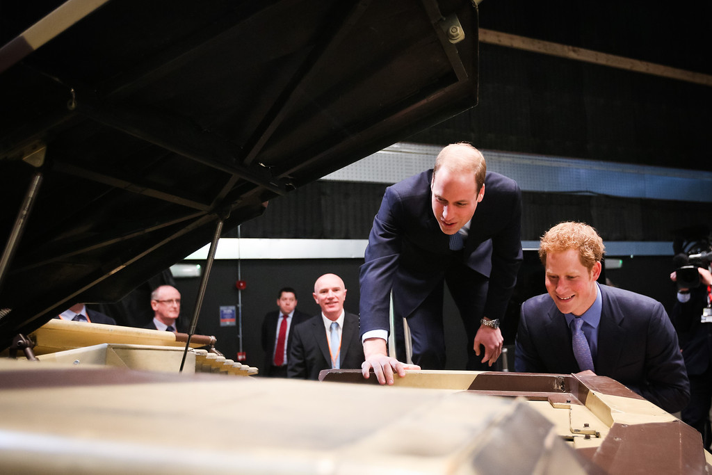 . Prince Harry (R) and Prince William, Duke of Cambridge inspect the \'Tumbler\', a vehicle used in the Batman films during the Inauguration Of Warner Bros. Studios Leavesden on April 26, 2013 in London, England.    (Photo by Paul Rogers - WPA Pool/Getty Images)