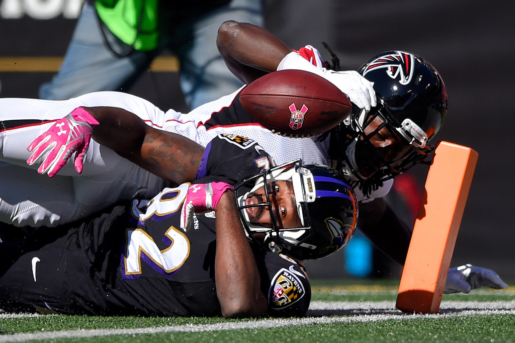 . Baltimore Ravens wide receiver Torrey Smith, bottom, comes up just short of a touchdown after being tackled by Atlanta Falcons cornerback Desmond Trufant in the first half of an NFL football game, Sunday, Oct. 19, 2014, in Baltimore. (AP Photo/Nick Wass)