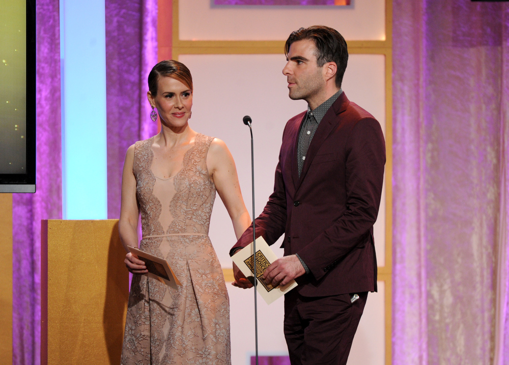 . Sarah Paulson, left, and Zachary Quinto speak on stage at the Critics\' Choice Television Awards in the Beverly Hilton Hotel on Monday, June 10, 2013, in Beverly Hills, Calif. (Photo by Frank Micelotta/Invision/AP)