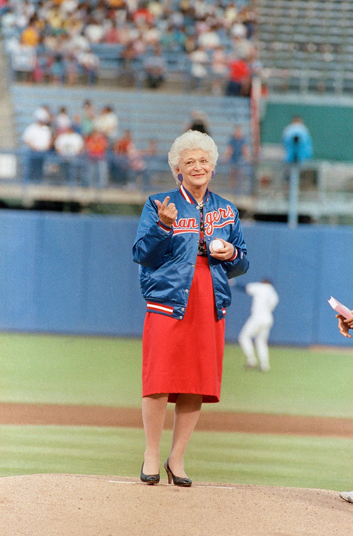 . First lady Barbara Bush motions for Texas Rangers catcher Geno Petralli to move in closer as she prepares to throw out the first pitch before the Rangers against the New York Yankees, May 4, 1989 in Arlington, Texas, Mrs. Bush\'s son, George W. Bush is one of the owners of the Rangers. (AP Photo/Pat Sullivan)