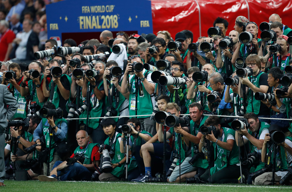 . Photographers line up as they wait for the presentation of the World Cup, after France defeated Croatia in the final match between France and Croatia at the 2018 soccer World Cup in the Luzhniki Stadium in Moscow, Russia, Sunday, July 15, 2018. France won the game 4-2. (AP Photo/Francisco Seco)