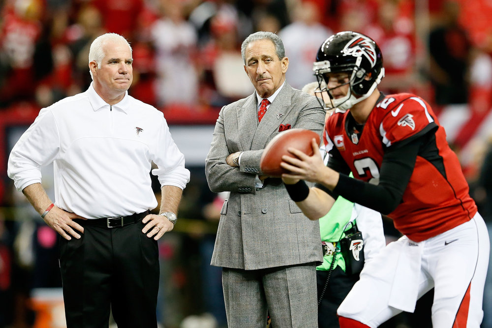 Description of . Head coach Mike Smith and owner Arthur Blank of the Atlanta Falcons watch quarterback Matt Ryan #2 of the Falcons warm up before taking on the San Francisco 49ers in the NFC Championship game at the Georgia Dome on January 20, 2013 in Atlanta, Georgia.  (Photo by Kevin C. Cox/Getty Images)