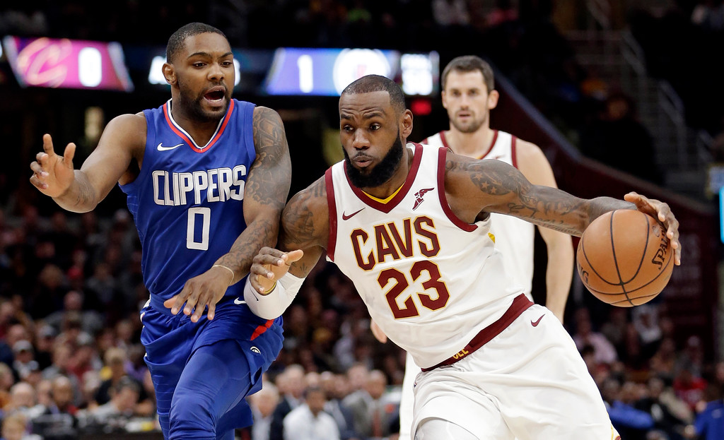 . Cleveland Cavaliers\' LeBron James (23) drives past Los Angeles Clippers\' Sindarius Thornwell (0) during the first half of an NBA basketball game, Friday, Nov. 17, 2017, in Cleveland. (AP Photo/Tony Dejak)