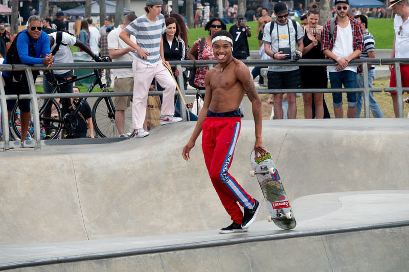 A local skateboarder works the crowd and prepares to make his moves in Venice Beach