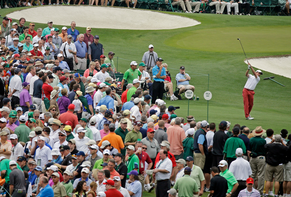 Description of . Mike Weir, of Canada, tees off on the third hole during the first round of the Masters golf tournament Thursday, April 11, 2013, in Augusta, Ga. (AP Photo/David J. Phillip)