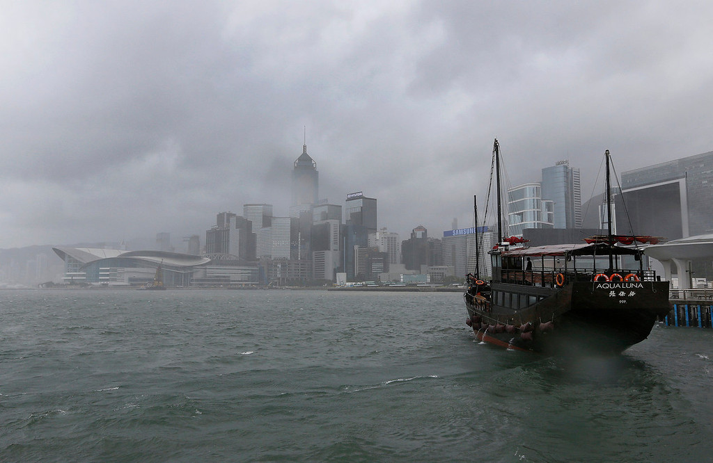 . A boat sails under strong wind at Hong Kong\'s Victoria Habour Tuesday, Aug. 13, 2013. The Observatory said Typhoon Utor intensified slightly as it moves towards the western coast of Guangdong. The typhoon battered the northern Philippines on Monday, toppling power lines and dumping heavy rain across cities and food-growing plains. (AP Photo/Vincent Yu)