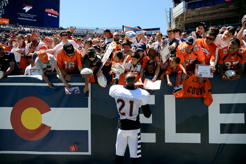 . Aqib Talib of Denver Broncos (21) signs autographs for the fans  after the Broncos scrimmage at Sports Authority Field at Mile High. Denver, Colorado. August 02. 2014. (Photo by Hyoung Chang/The Denver Post)