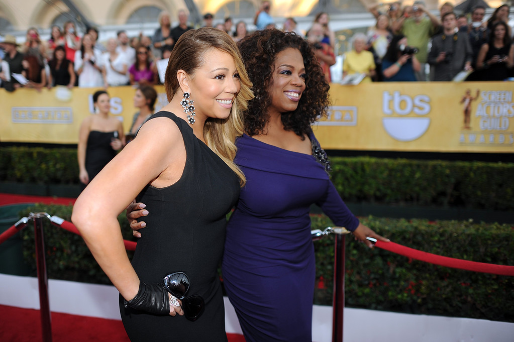 . Mariah Carey and Oprah Winfrey on the red carpet at the 20th Annual Screen Actors Guild Awards  at the Shrine Auditorium in Los Angeles, California on Saturday January 18, 2014 (Photo by Hans Gutknecht / Los Angeles Daily News)