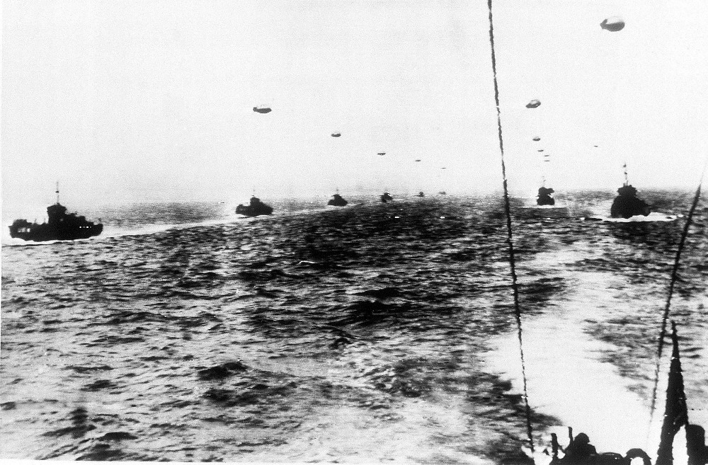 Description of . Off the British coast, this huge fleet of warships, transports and landing craft awaits the signal to get underway for the allied invasion of Northern France, June 6, 1944. (AP Photo)