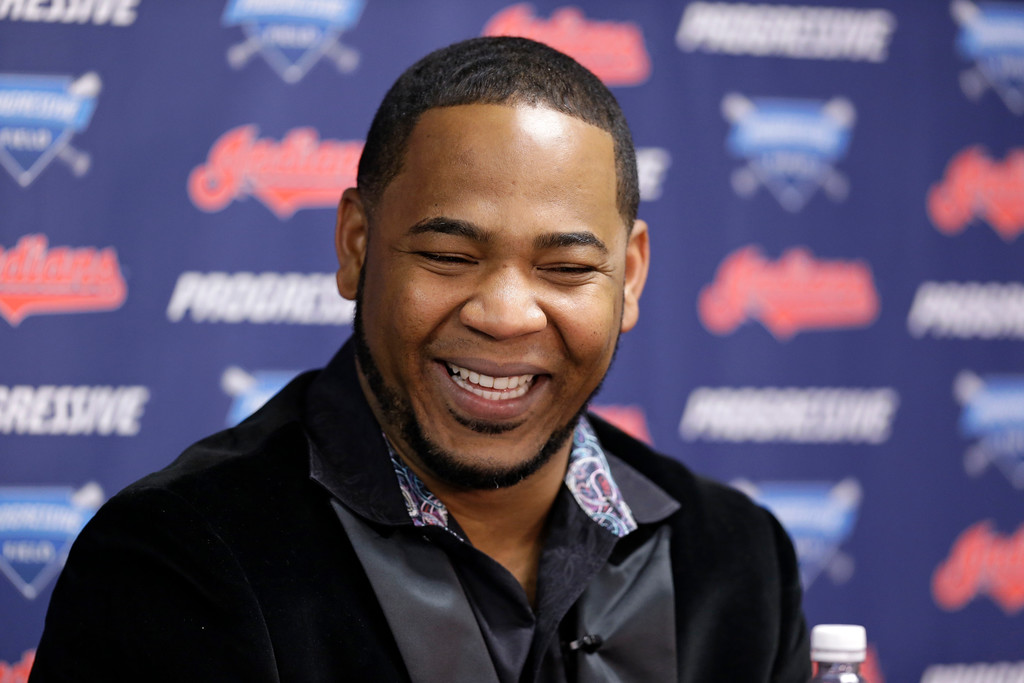 . Cleveland Indians\' Edwin Encarnacion smiles during a news conference, Thursday, Jan. 5, 2017, in Cleveland. One win from a World Series title last season, the Cleveland Indians finalized a $65 million, three-year contract with free agent slugger Encarnacion. (AP Photo/Tony Dejak)