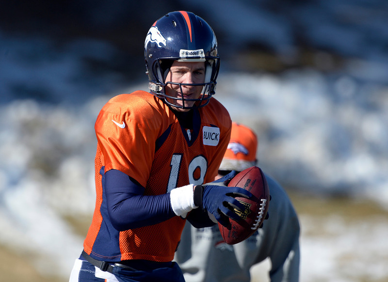 . Denver Broncos quarterback Peyton Manning (18) runs through drills during practice January 8, 2014 at Dove Valley. The Denver Broncos are preparing for their Divisional Game against the San Diego Chargers at Sports Authority Field. (Photo by John Leyba/The Denver Post)