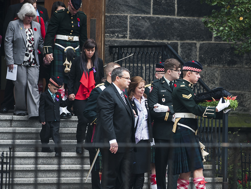. Kathy Cirillo (3rd R),  the wife of Cpl. Nathan Cirillo Laureen Cirillo, walks as her son Marcus Cirillo (2nd L), follows behind during Nathan Cirillo\'s funeral at the Christ\'s Church Cathedral on October 28, 2014 in Hamilton, Ontario, Canada.   (Photo by Aaron Vincent Elkaim/Getty Images)
