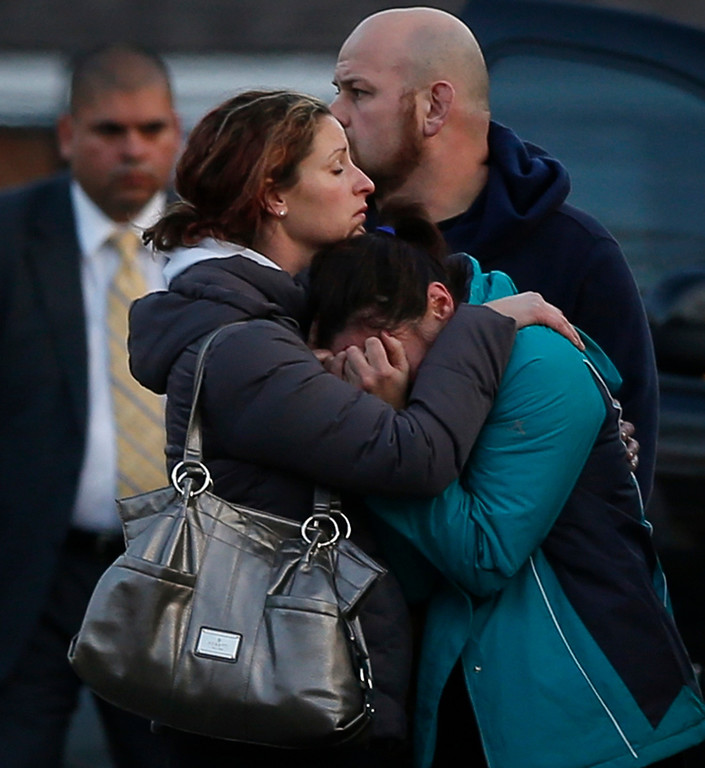 . The families of victims grieve near Sandy Hook Elementary School, were a gunman opened fire on school children and staff in Newtown, Connecticut on December 14, 2012. A heavily armed gunman opened fire on school children and staff at a Connecticut elementary school on Friday, killing at least 26 people, including 20 children, in the latest in a series of shooting rampages that have tormented the United States this year. REUTERS/Adrees Latif