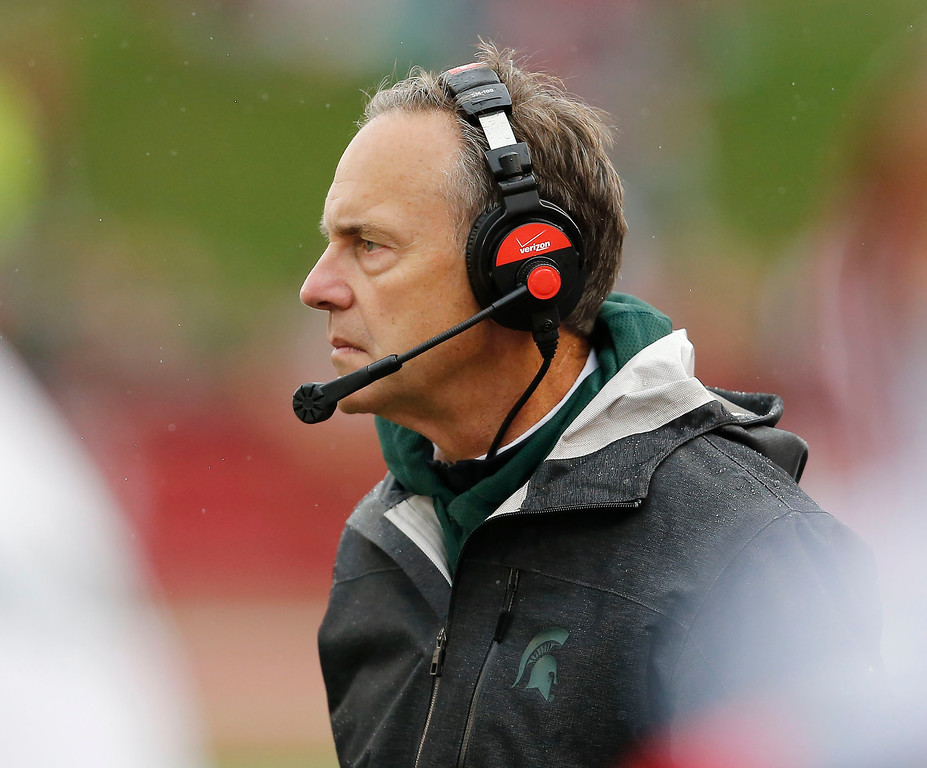 . Michigan State  head coach Mark Dantonio watches his team during the first half of an NCAA college football game in Bloomington, Ind., Saturday, Oct. 18, 2014. Michigan State won the game 56-17. (AP Photo/Sam Riche)