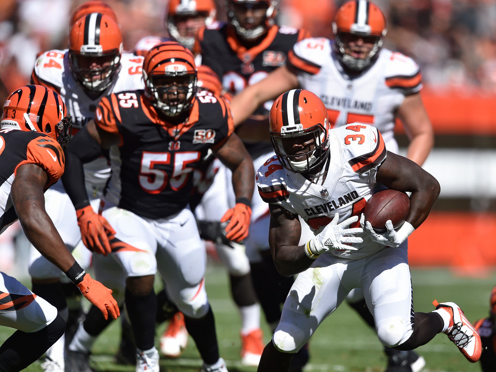 . Cleveland Browns running back Isaiah Crowell (34) runs for a first down in the first half of an NFL football game against the Cincinnati Bengals, Sunday, Oct. 1, 2017, in Cleveland. (AP Photo/David Richard)