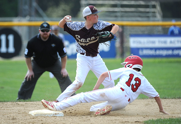 8/7/2018 Mike Orazzi | Staff Fairfield American's Robbie Donahue (13) forced out at second by Maine's Jeremiah Chessie (7) at Breen Field in Bristol Tuesday.