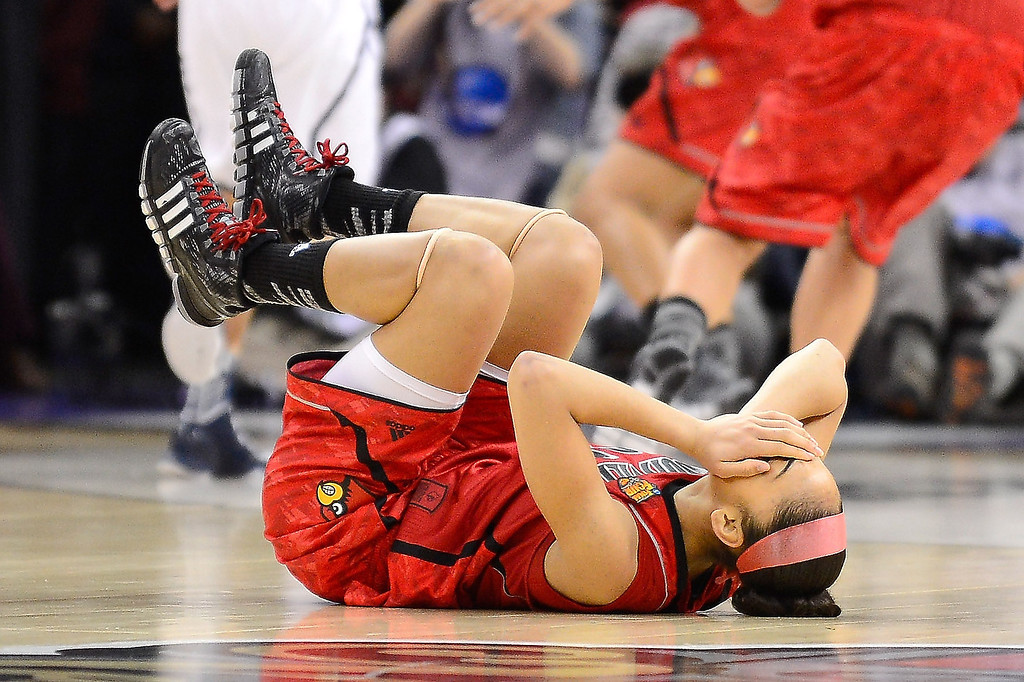. Bria Smith #21 of the Louisville Cardinals lays on the court after a flagrant foul by Caroline Doty #5 of the Connecticut Huskies in the first half during the 2013 NCAA Women\'s Final Four Championship at New Orleans Arena on April 9, 2013 in New Orleans, Louisiana.  (Photo by Stacy Revere/Getty Images)